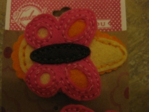 Felt snap-clip barettes, in bright colors on boutique card